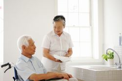 Patient and caregiver in senior home