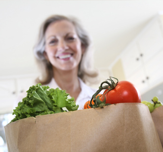 Woman with a bag of groceries