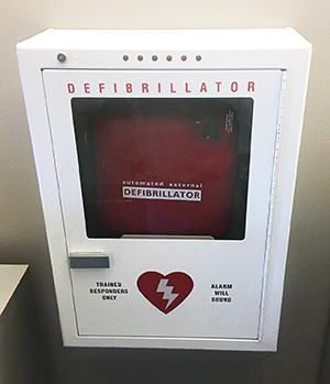 Automated external defibrillator machine on wall.