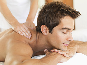 Image of a massage therapist giving a deep tissue massage.