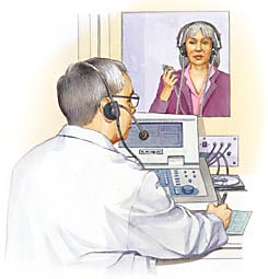 Hearing specialist testing woman's hearing
