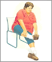 Woman sitting in a chair holding foot