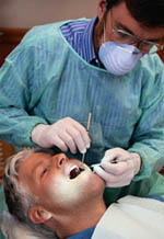 Picture of man during a routine teeth cleaning
