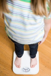 Girl standing on a scale