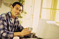 Picture of a man sitting at a computer