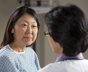 Close up of female doctor and female patient talking.