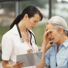 Confused older woman with nurse