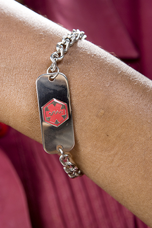 Close up of Medicalert bracelet.
